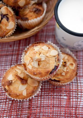 Muffins with almonds and cherries and milk