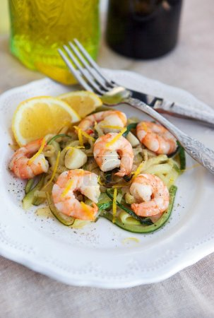 Zucchini noodles with prawns and lemon zest