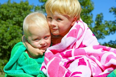 Cute Brothers Hugging in Beach Towels