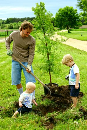 Father and Children Plating Tree