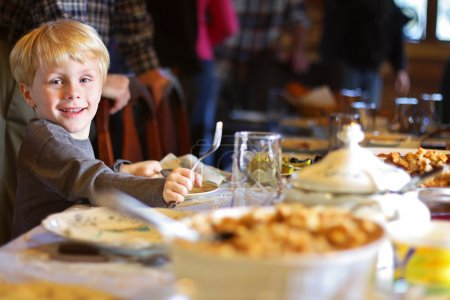Child Sitting at Table for Holiday Dinner