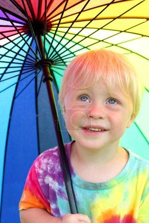 Little Child Under Rainbow Rain Umbrella