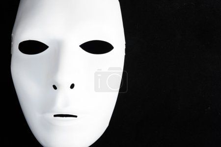 White mask in black isolated...