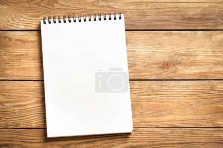 Photo for Blank notepad on a wooden surface. - Royalty Free Image