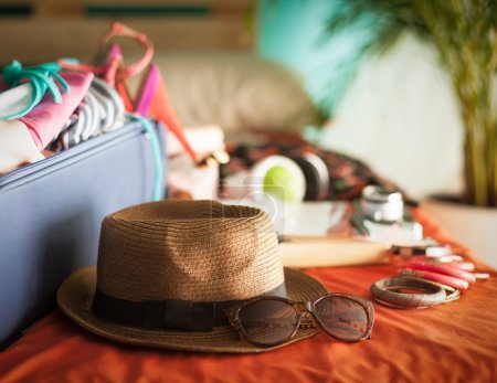 Photo for Woman's bedroom full of things ready to be taken on summer holiday. - Royalty Free Image