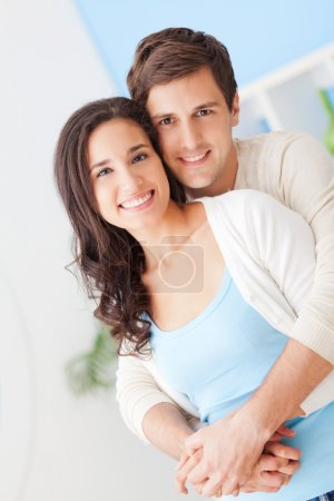 Photo for Happy young couple in their modern living room. - Royalty Free Image