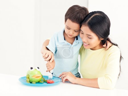 Mother and Son Eating