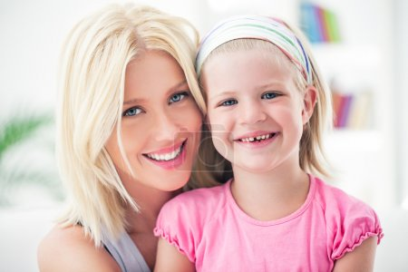 Photo for Mother and her daughter posing and smiling. - Royalty Free Image