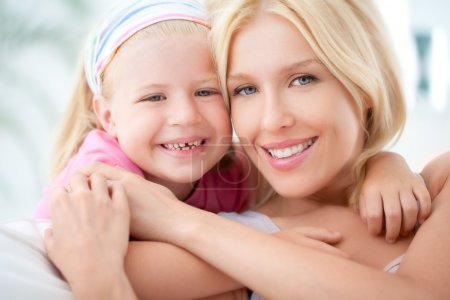 Photo for A mother and her daughter hugging and smiling. - Royalty Free Image