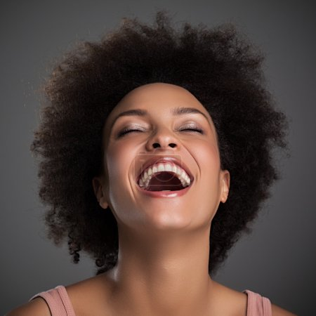 Photo for Portrait of a beautiful African woman laughing. - Royalty Free Image