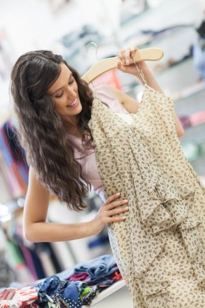 Smiling Woman Buying a Dress
