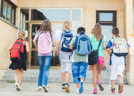 Photo for Group of kids going to school together. - Royalty Free Image