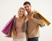 Smiling Couple Holding Shopping Bags