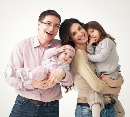 Photo for Portrait of a happy four-member family. - Royalty Free Image