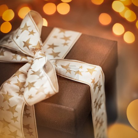 Photo for Brown Christmas present in close-up. - Royalty Free Image