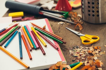 Photo for Messy desk of a primary school student. - Royalty Free Image