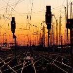 Railroad Tracks at a Major Train Station at Sunset...