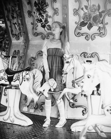 Girl posing on carousel