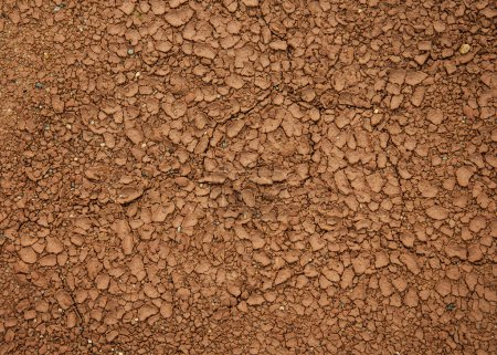 Top view of red dry soil texture