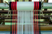 Yarn pattern is set up on the loom bench and ready to weave