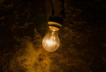 old light bulb in cave