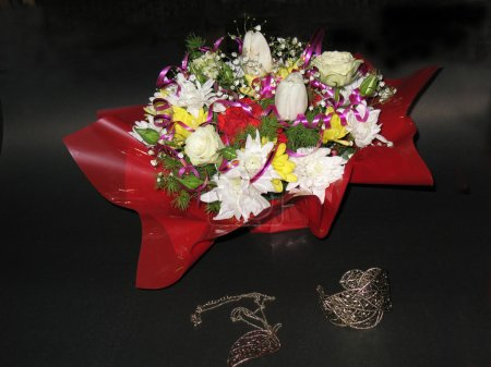 Floral arrangement and women's jewelry