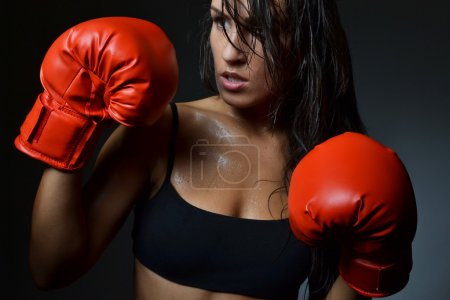Photo for Beautiful woman with the red boxing gloves, studio shot - Royalty Free Image