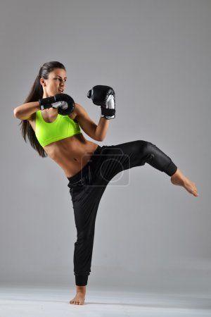 Photo for Beautiful fitness woman with the black boxing gloves, studio shot - Royalty Free Image