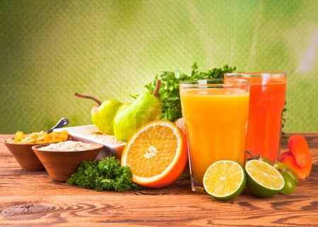 Photo for Fresh fruits, vegetables and juice isolated on wood - Royalty Free Image