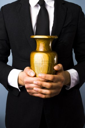 Man with urn