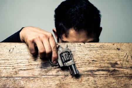 Student at school desk with gun detail