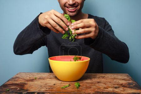 Photo for Happy man tossing salad - Royalty Free Image