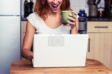 Woman is excited about her laptop