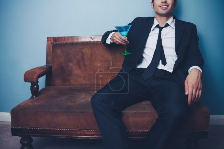 Businessman relaxing with a cocktail after work