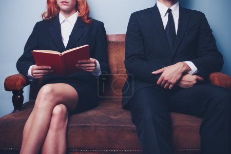 Photo for Man and woman waiting to enter a job interview - Royalty Free Image