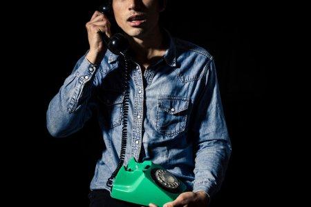 Man taking disturbing phone call