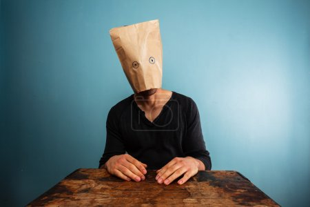 Stupid man with bag over his head...
