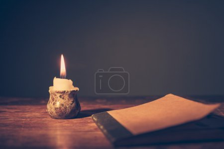 Notebook and candle