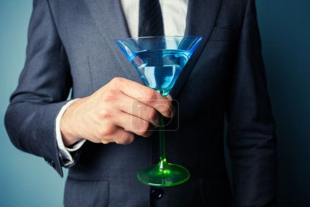 Businessman with cocktail glass