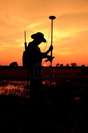 Surveyor worker make data collection with GPS surveying , Silhouette