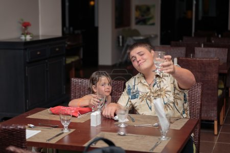 Joyful and funny kids celebrate their vacation time