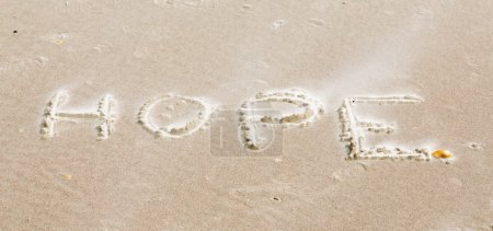 Photo for We came across this uplifting message while walking our dogs on the beach. Someone had scrached this encouragement in the sand. Later it became windy and dry sand had partially filled the depression in the wet sand. - Royalty Free Image