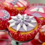 Tasty cupcake on standard...