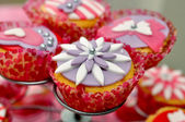 Tasty cupcake on standard