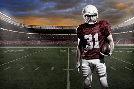 Photo for Football player with a red uniform, in a stadium with fans wearing red uniform - Royalty Free Image