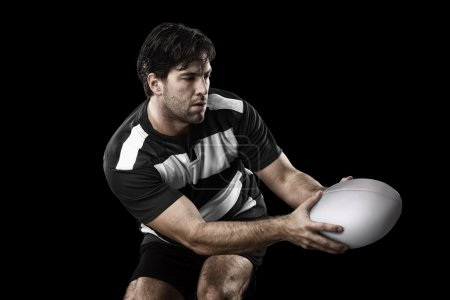 Rugby player in a black and white uniform. Black B...