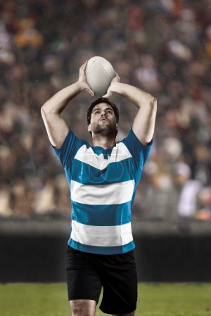 Rugby player in a blue uniform on a stadium....