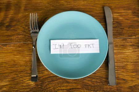 Photo for Weight loss concept too fat message on plate - Royalty Free Image