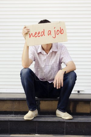 A man with a sign on the job search