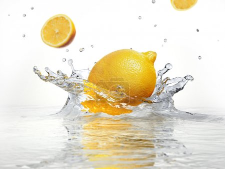 Photo for Lemon splashing into clear water on white background. - Royalty Free Image
